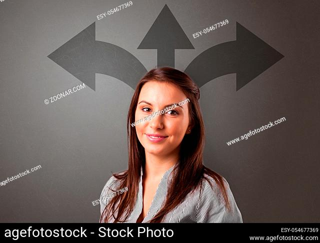 Business person choosing between two directions