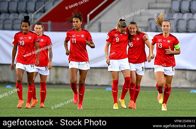 Switzerland's Malin Gut celebrates with teammates after scoring during a soccer game between Switzerland and Belgium's Red Flames