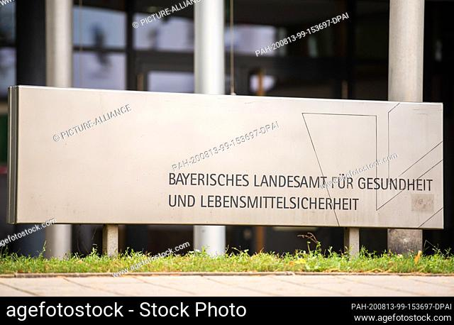 13 August 2020, Bavaria, Erlangen: In front of the building of the Bavarian State Office for Health and Food Safety there is a sign with the name of the State...