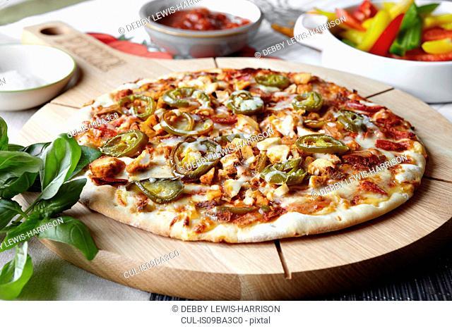 Fajita pizza on wooden pizza board, close-up
