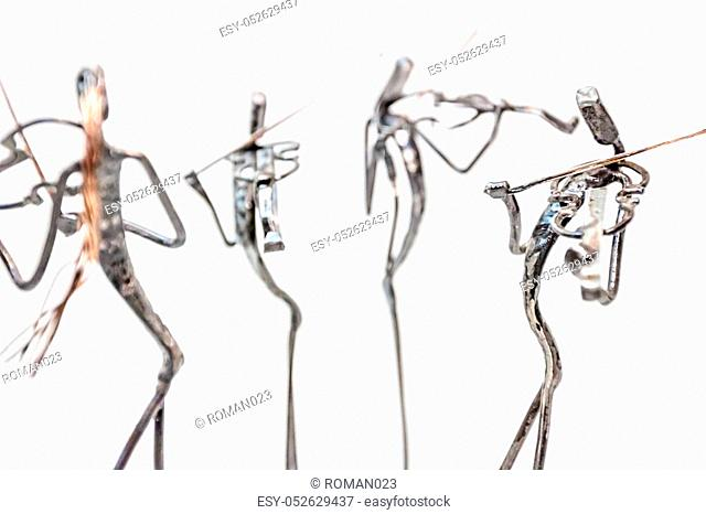 Figures of music performers made with welded black metal wire, violinists are playing together living lines