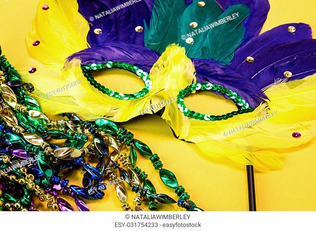 Close up of mardigras mask on yellow background