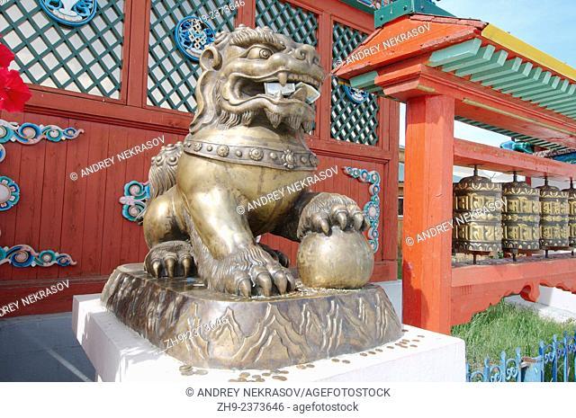 Bronze lion near the entrance to the Datsan. Ivolginsky Datsan - Buddhist Temple, Buryatia, Russian Federation