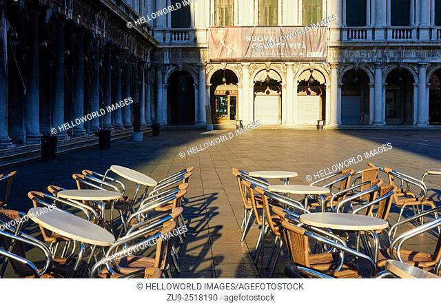 Early sunlight lights up an empty Piazza San Marco, Venice, Veneto, Italy, Europe