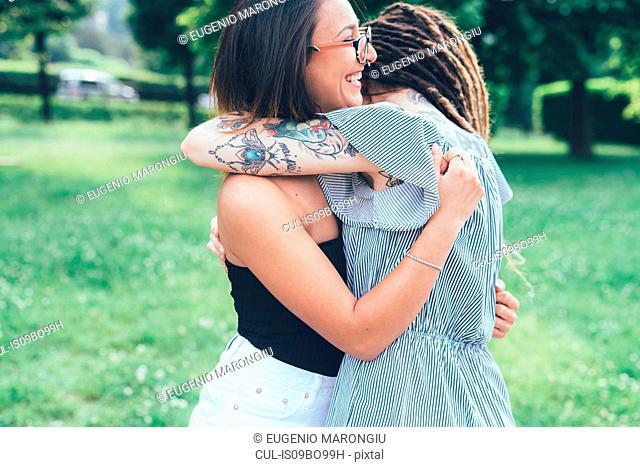 Girlfriends hugging in park