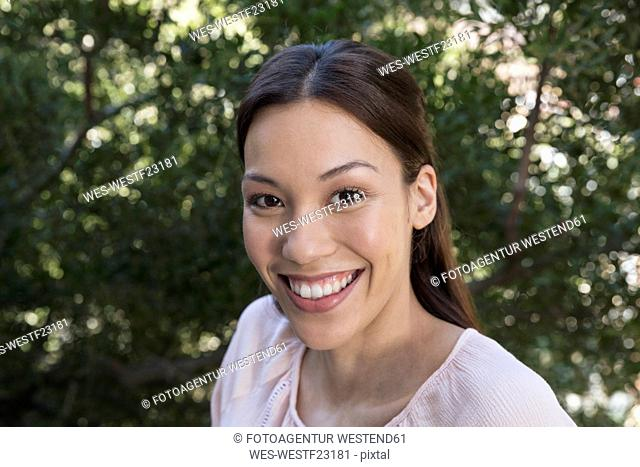 Portrait of smiling young woman outdoors