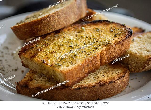 Grilled bread with olive oil and origano in a restaurant at Poulithra village. Arcadia, Peloponnese, Greece
