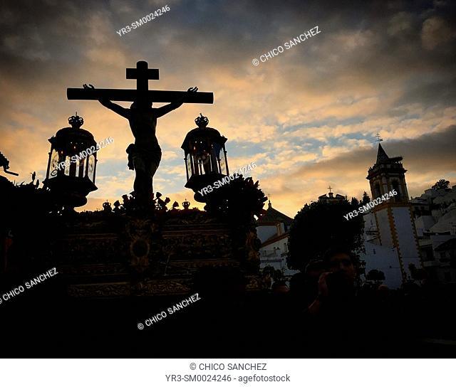 A sculpture of Jesus Christ crucified is carried at sunset during Semana Santa in Prado del Rey, Sierra de Cadiz, Andalusia, Spain