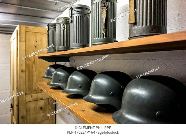 German WWII M1942 Stahlhelms / helmets and gas mask canisters at the Raversyde Atlantikwall / Atlantic Wall open-air museum at Raversijde, West Flanders