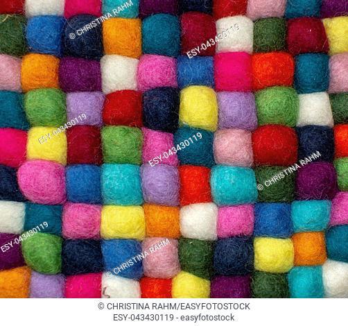 Colorful felted little balls full frame decorative background