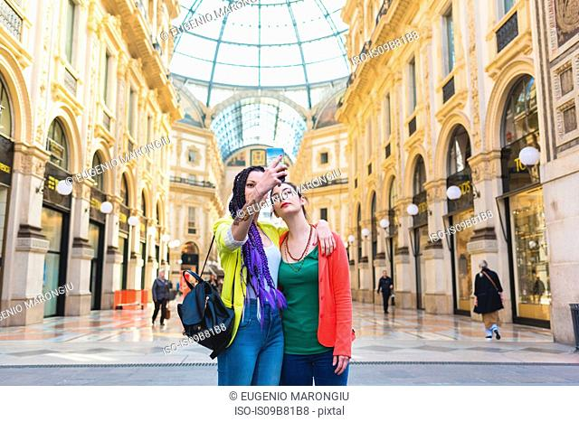 Women taking selfie in the Galleria Vittorio Emanuele II, Milan, Italy