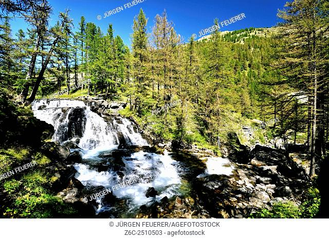 Dreamy waterfall Fontcouverte in the valley of the river Clarée, side view, Hautes-Alpes, French Alps, France