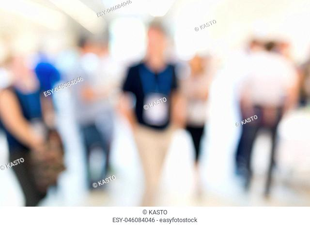 Abstract blurred people socializing during coffee break at business conference