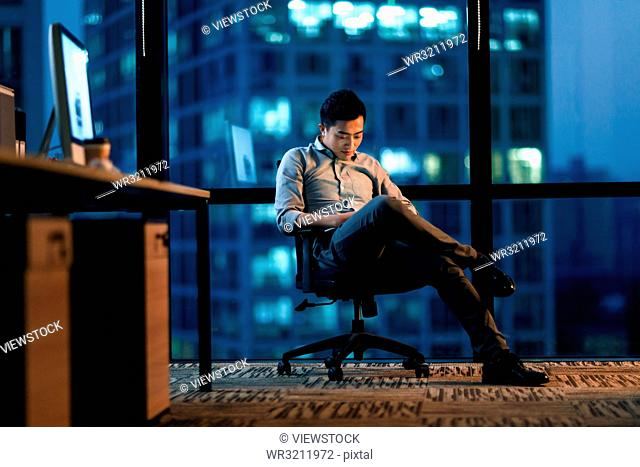 Business men in the office to work overtime