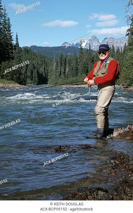 Flyfisherman fishing for steelhead on remote northern river, British Columbia, Canada