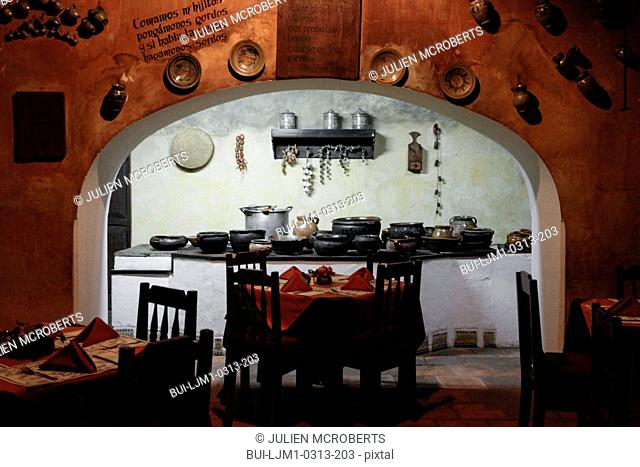View of kitchen with seating arrangement in a restaurant at Antigua; Guatemala