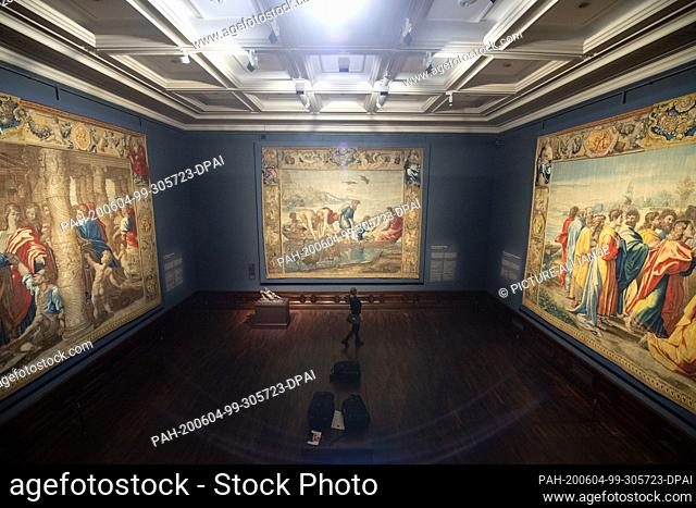 """04 June 2020, Saxony, Dresden: A woman stands during a press tour in the exhibition """"""""Raphael - Power of Images. The tapestries and their effect"""""""" in front of..."""
