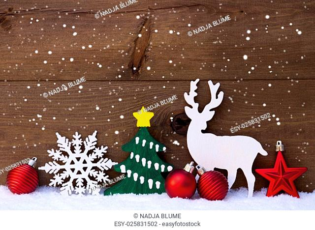 Christmas Decoration With Reindeer On White Snow. Green Tree, Snowflakes And Red Christmas Balls. Brown, Rustic, Vintage Wooden Background For Copy Space
