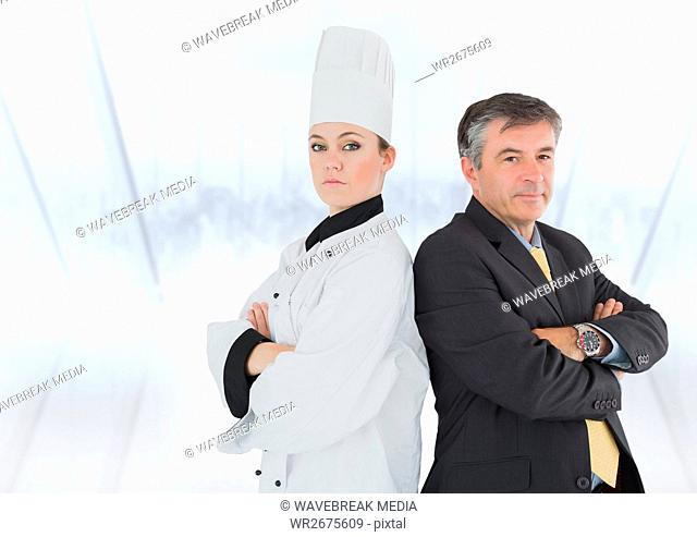 Portrait of female chef and businessman with arms crossed