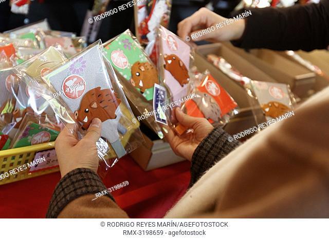 December 17, 2018, Tokyo, Japan - Visitors shop traditional Hagoita (Battledores) during the Hagoita-Ichi fair at the Sensoji Temple in Asakusa