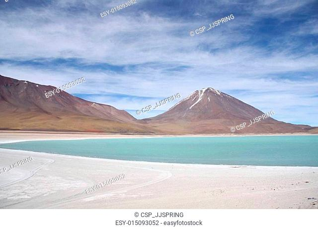 Green lagoon and Volcano in Atacama