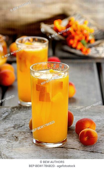 Orange drink on wooden table, selective focus