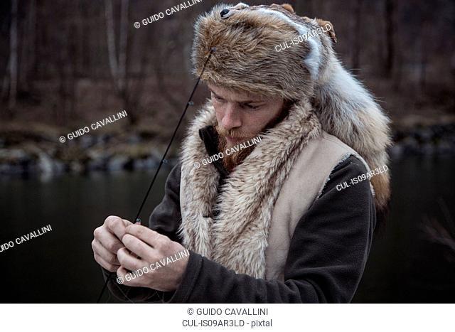 Mid adult man holding fishing line