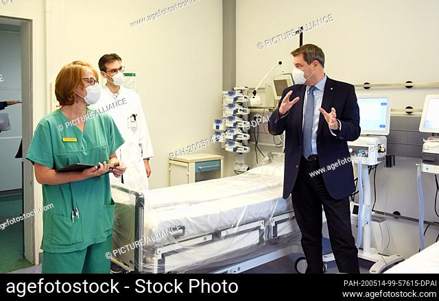 14 May 2020, Bavaria, Munich: Esther Kaaden (l-r), head of the nursing ward, Niklas Schneider, physician in charge of the ward, and Markus Söder (CSU)