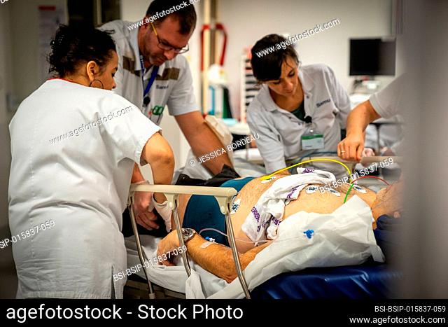 A patient who is not very lucid is placed under electrodes in intensive care to monitor his heart rate
