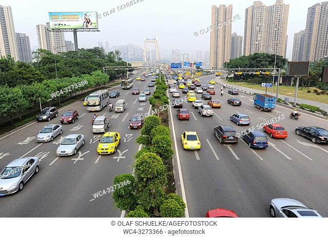 Chongqing, China, Asia - View of the daily traffic volume outside the city centre. The megacity is situated at the confluence of two main waterways