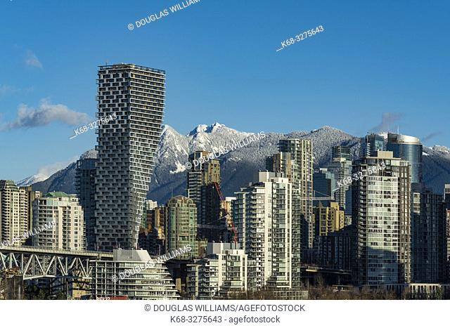 Skyline, dominated by Vancouver House, designed by Bjarke Ingels Group, from the south side of False Creek, Vancouver, BC, Canada