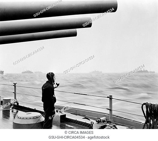 U.S. Navy Sailor on Naval Vessel Keeping Alert Watch over Merchant Ships Delivering Vital Supplies to U.S. and Allied Forces in Europe, Atlantic Ocean