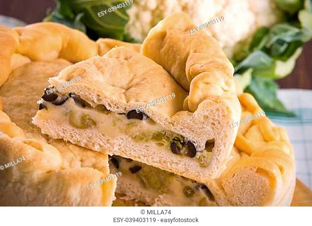 Calzone stuffed with olive and cauliflower