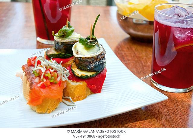 Spanish appetizer: tapas and tinto de verano in a terrace. Madrid, Spain
