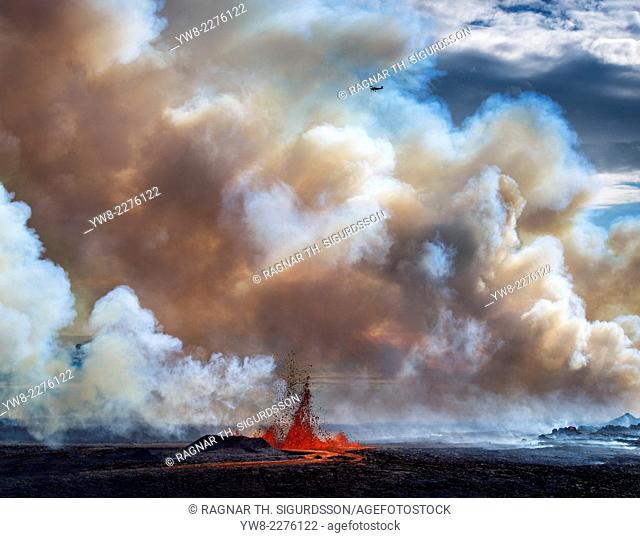 Volcano Eruption, Holuhraun-near the Bardarbunga Volacano, Iceland. Thick Plumes and Lava Fountains with a small plane flying over the eruption site