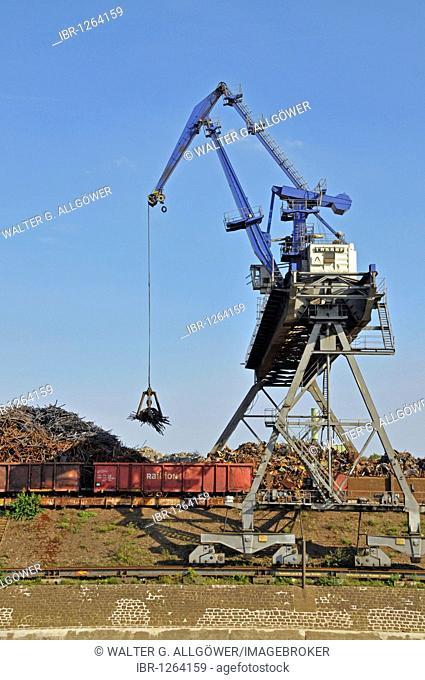 Overhead crane unloading scrap metal, scrap island, DuisPort inland port, Duisburg, North Rhine-Westphalia, Germany, Europe