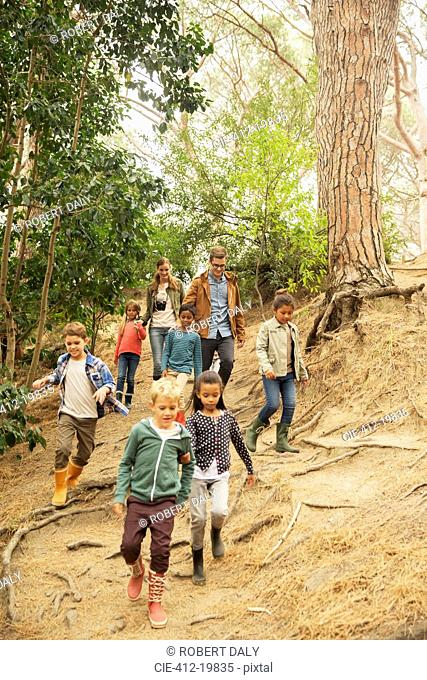 Students and teachers walking in forest