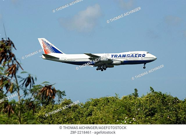 Boeing 747-200 from the line Transaero by the approach to the airport in Punta Cana, Dominican Republic