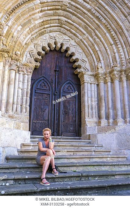 Woman in a church door. San Pedro de la Rua church. Estella. Navarre, Spain, Europe