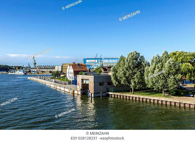 WOLGAST, GERMANY - AUG 13, 2015: view at river Peene to dockyard area in Wolgast. The Peene dockyard was founded in 1948 by the russian troups