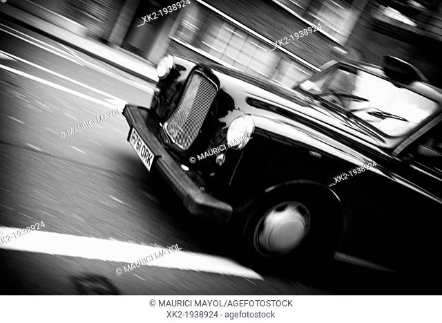 Classical old Black cab , taxi panning, detail of the front, London, UK