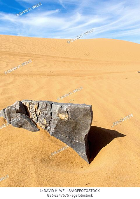 Stone and rippled sand on desert, Morocco