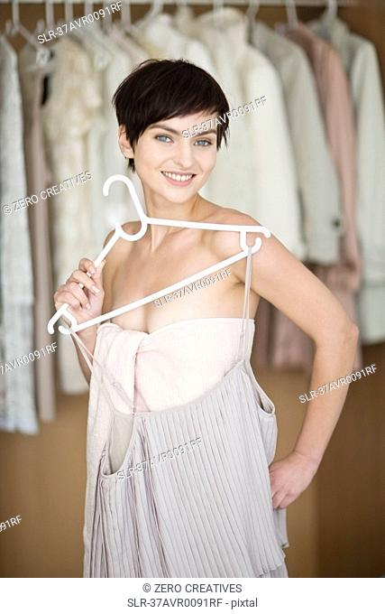 Woman picking clothes from closet
