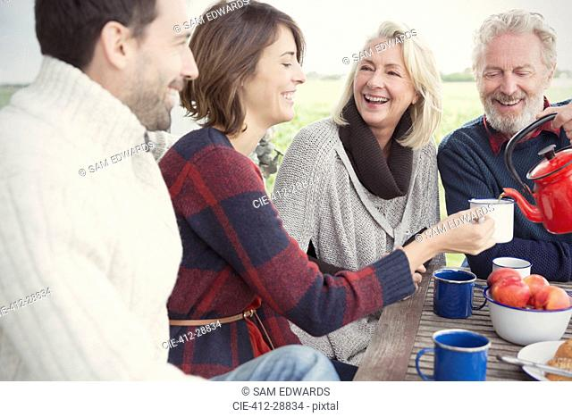 Couples drinking coffee on patio