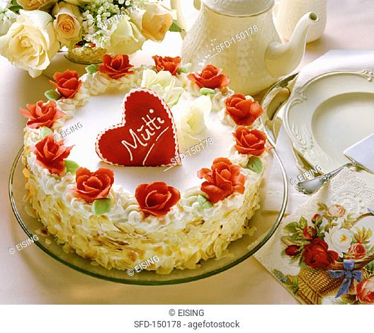 White cream gateau with red marzipan roses for Mother's Day