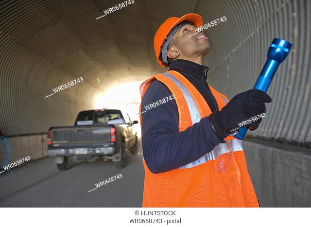 Engineer inspecting a tunnel