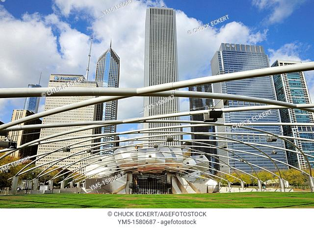 Pritzker Pavillion in Chicago's Millennium Park. The overhead grid supports the speaker system and sound coming from the stage or band shell