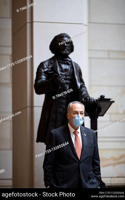 United States Senate Minority Leader Chuck Schumer (Democrat of New York) stands beside the statue of Frederick Douglass before an event to commemorate the life...