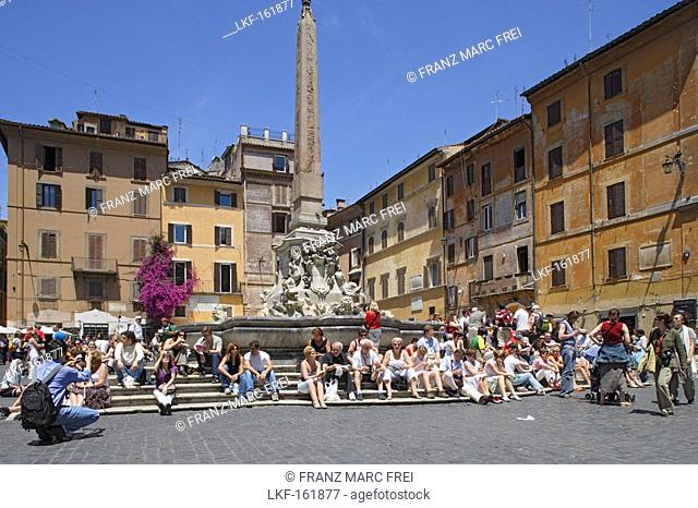 People sitting at a fountain in the sunlight, Piazza della Rotonda, Rome, Italy, Europe