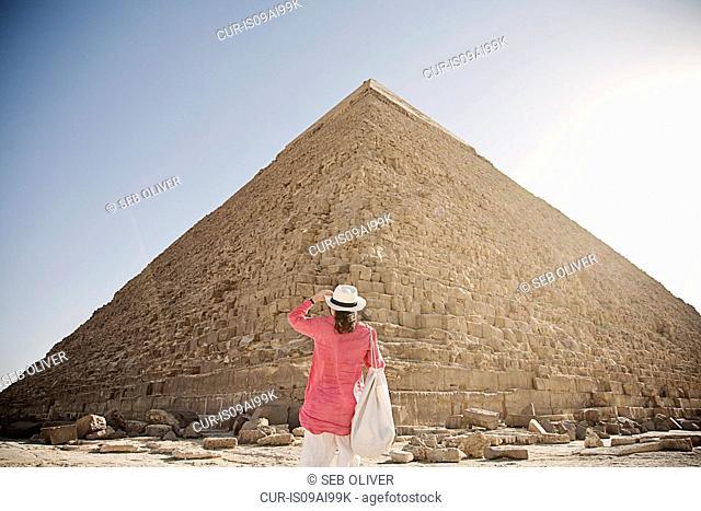 Mature woman tourist at The Great Pyramid of Giza, Egypt